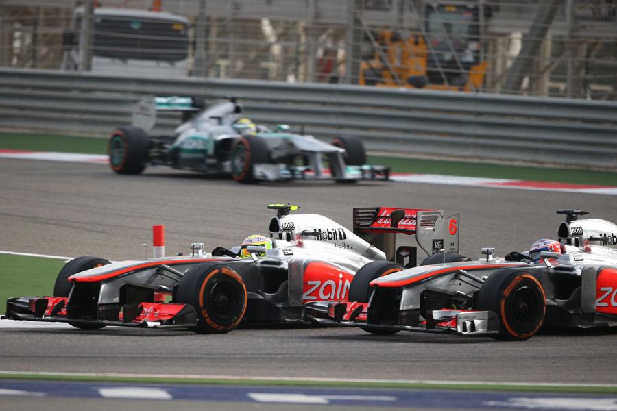 Sergio Perez and Jenson Button battle through Turn 1