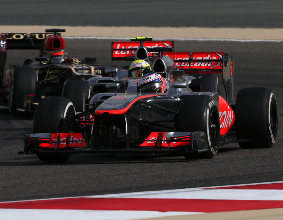 Jenson Button holds off Sergio Perez