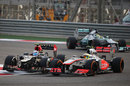 Romain Grosjean goes wheel-to-wheel with Sergio Perez