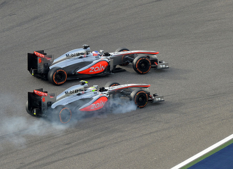 Sergio Perez attacks Jenson Button in to Turn 1