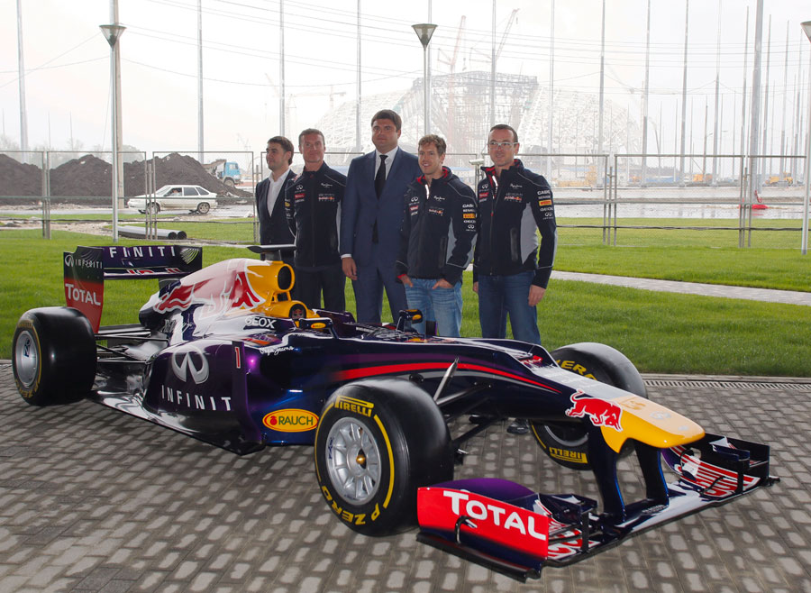 Sebastian Vettel poses with officials while visiting the Sochi Olympic Park