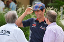 Mark Webber steals Sir Jackie Stewart's hat