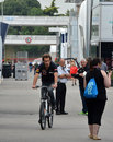 Jean-Eric Vergne cycles through the paddock