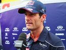 Mark Webber grimaces at the media