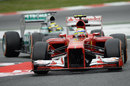 Felipe Massa leads Nico Rosberg through the chicane