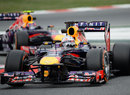 Sebastian Vettel leads Mark Webber through the chicane