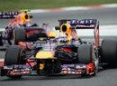 Sebastian Vettel leads Mark Webber through the chicane