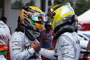 Lewis Hamilton celebrates with Nico Rosberg after locking out the front row