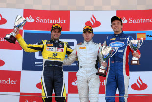 Robin Frijns celebrates on the podium with Felipe Nasr and Jolyon Palmer