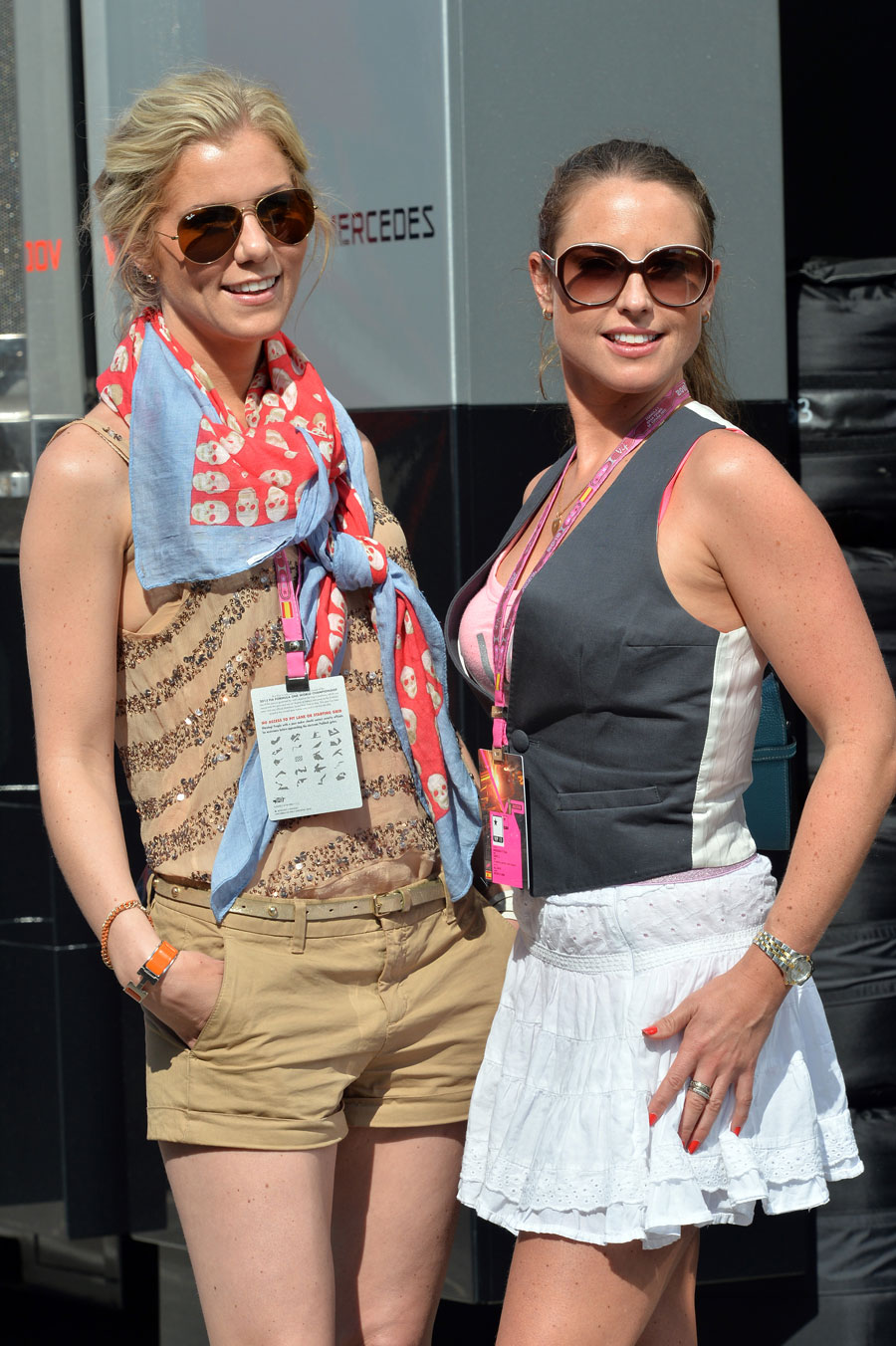 Two VIPs enjoy the sunshine in the paddock
