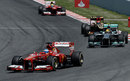 Fernando Alonso leads Lewis Hamilton early in the race