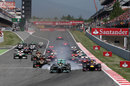 Lewis Hamilton locks up behind Nico Rosberg into turn one