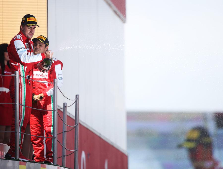 Fernando Alonso celebrates on the podium