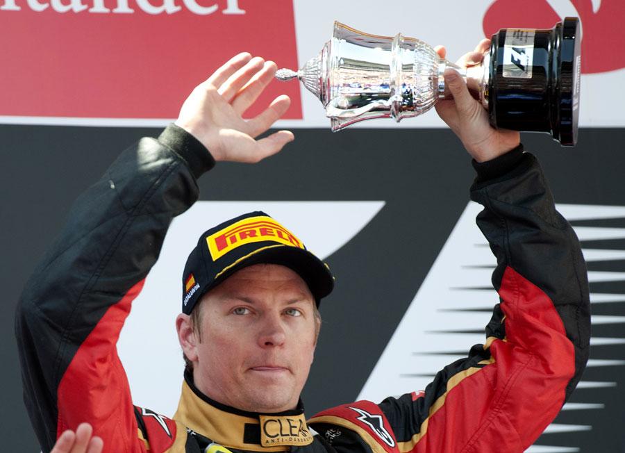 Kimi Raikkonen celebrates second place