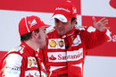 Felipe Massa talks with Fernando Alonso on the podium