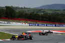 Mark Webber is chased by Nico Hulkenberg in the final sector