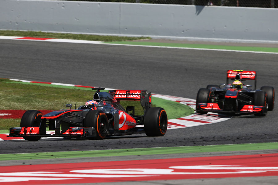 Jenson Button leads Sergio Perez on track