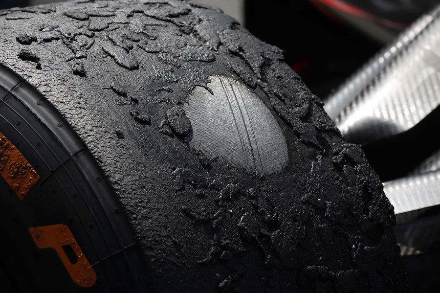 The heavily worn tyre on Sergio Perez's McLaren after the race