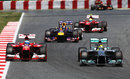 Nico Rosberg holds off Fernando Alonso early in the race