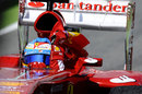 Fernando Alonso celebrates with a Spanish flag