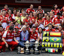 Fernando Alonso celebrates with the Ferrari team and his mother and father