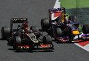 Kimi Raikkonen goes wheel to wheel with Sebastian Vettel in turn two