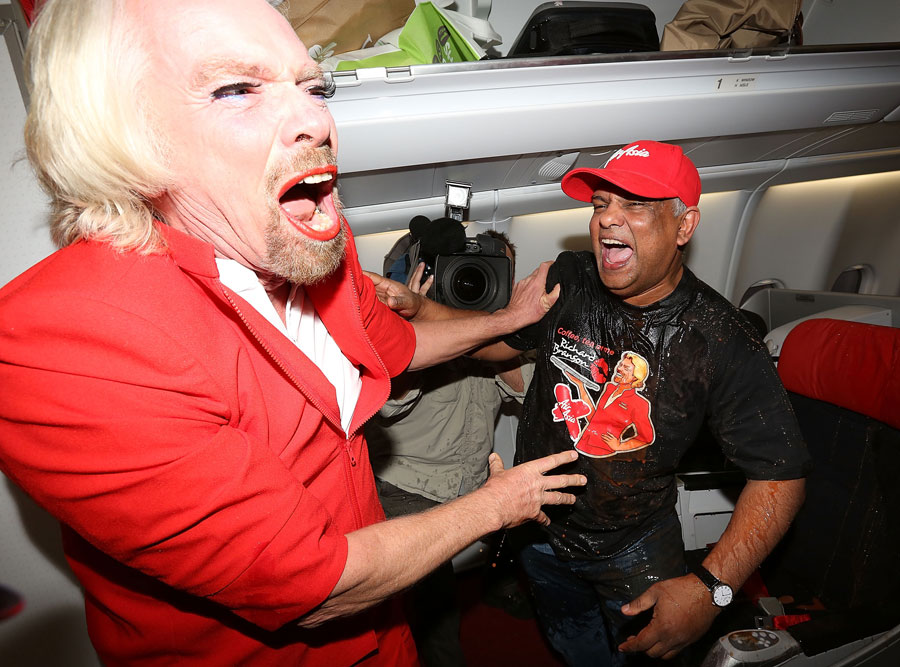 Sir Richard Branson pours drinks on AirAsia boss Tony Fernandes