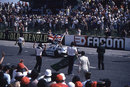 Alan Jones celebrates victory with the Union Flag