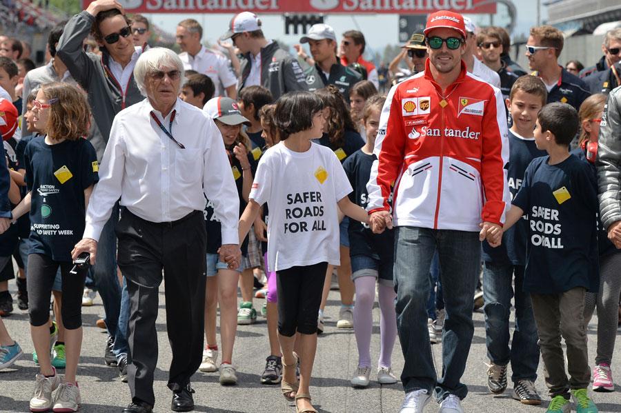 Bernie Ecclestone and Fernando Alonso supporting an FIA initiative