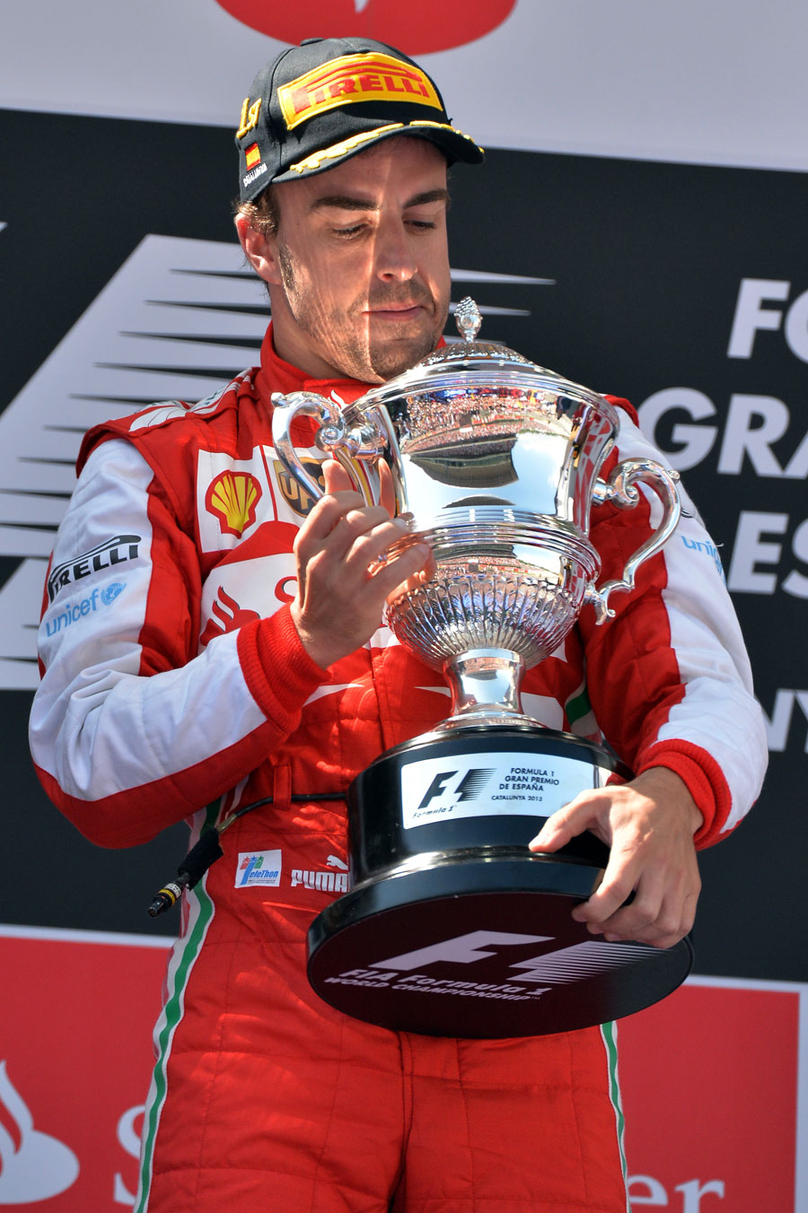 Fernando Alonso admires his winner's trophy
