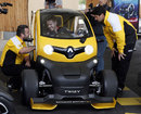 Sebastian Vettel drives a Renault F1 Twizy on a visit to Viry