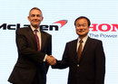 Martin Whitmarsh shakes hands Honda president Takanobu Ito after agreeing an engine supply deal from 2015