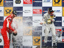 Raffaele Marcielo is showered in champagne after victory at Brands Hatch