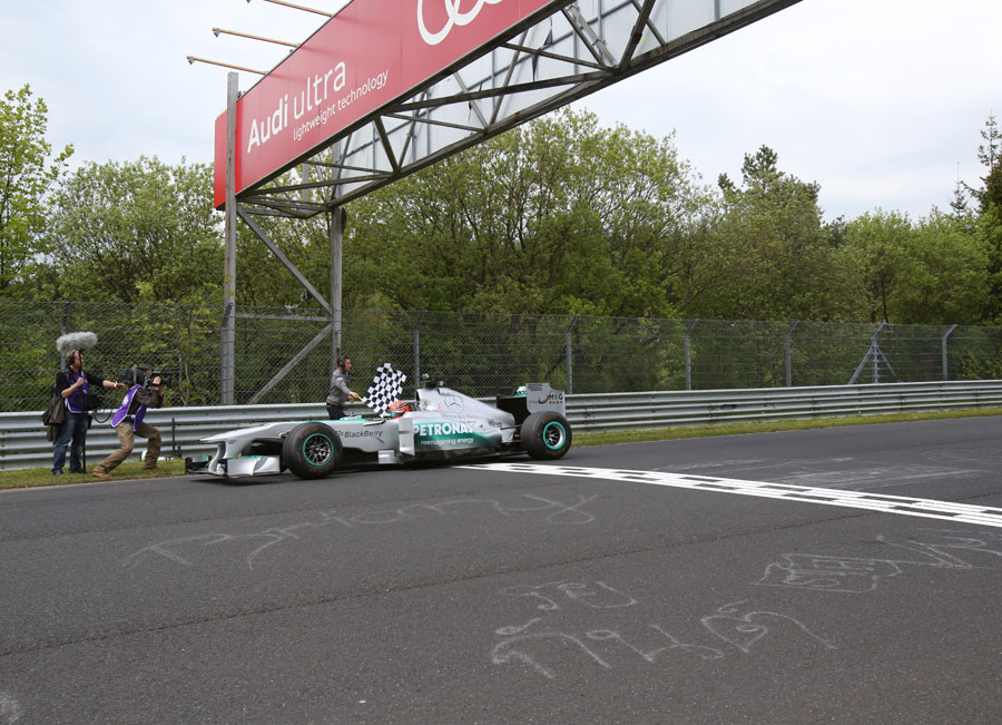 Michael Schumacher finishes his demonstration lap of the Nurburgring Nordschleife in a Mercedes F1 car