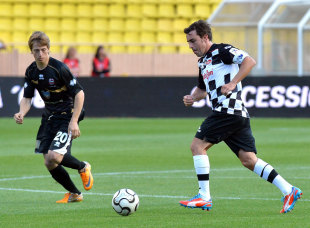 Fernando Alonso on the ball during the traditional pre-race football match in Monaco