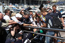 Sebastian Vettel signs autographs for his fans
