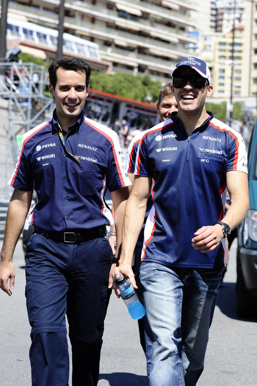 Pastor Maldonado walks the track with Williams data engineer Xavier Marcos