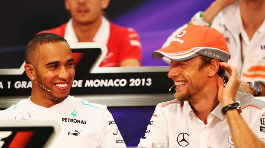 Lewis Hamilton and Jenson Button share a joke in the driver press conference
