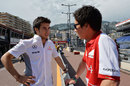 Sergio Perez chats to former Sauber team-mate Kamui Kobayashi in the pit lane