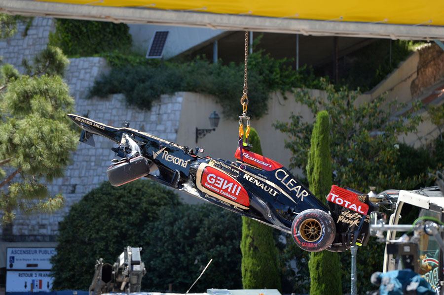 Romain Grosjean's damaged Lotus is craned away