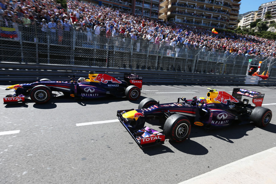 Sebastian Vettel and Mark Webber salute the fans at the end of the race