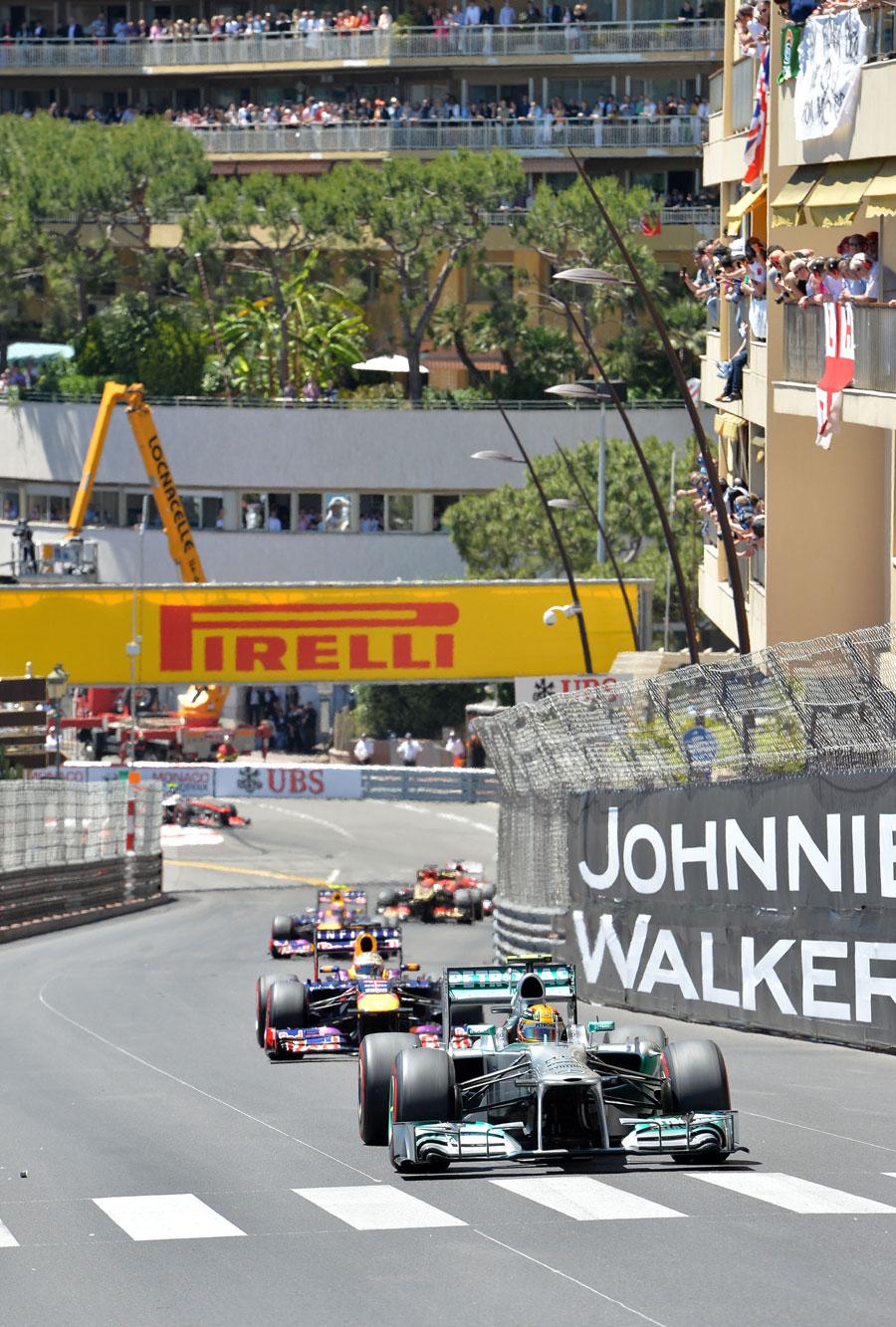 Lewis Hamilton leads Sebastian Vettel and Mark Webber up towards Massenet