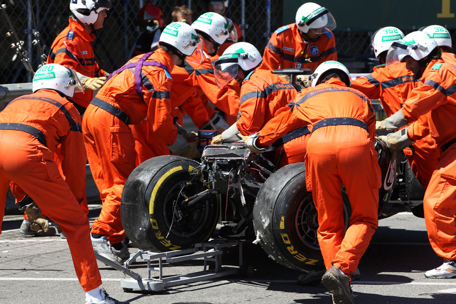 Marshals work to clear Pastor Maldonado's wrecked Williams