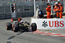 Romain Grosjean limps back to the pit lane with a broken front wing