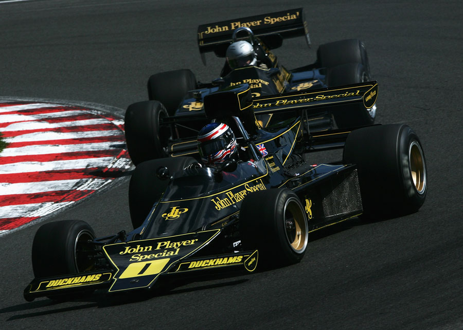 A Lotus 76 and a Lotus 92 racing in the FIA Masters Historic Formula One Championship
