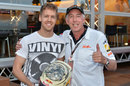 Sebastian Vettel poses with Keith Sutton and his special Monaco helmet with photos from Sutton Images