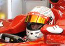 Kamui Kobayashi ahead of testing a 2010 Ferrari