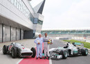 Sir Stirling Moss and Lewis Hamilton pose for a photo with a Mercedes W196 and Mercedes W02