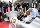 Sir Stirling Moss shows Lewis Hamiltonthe controls of his Mercedes W196