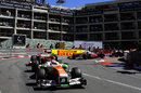 Adrian Sutil leads Fernando Alonso and Jenson Button out of Loews